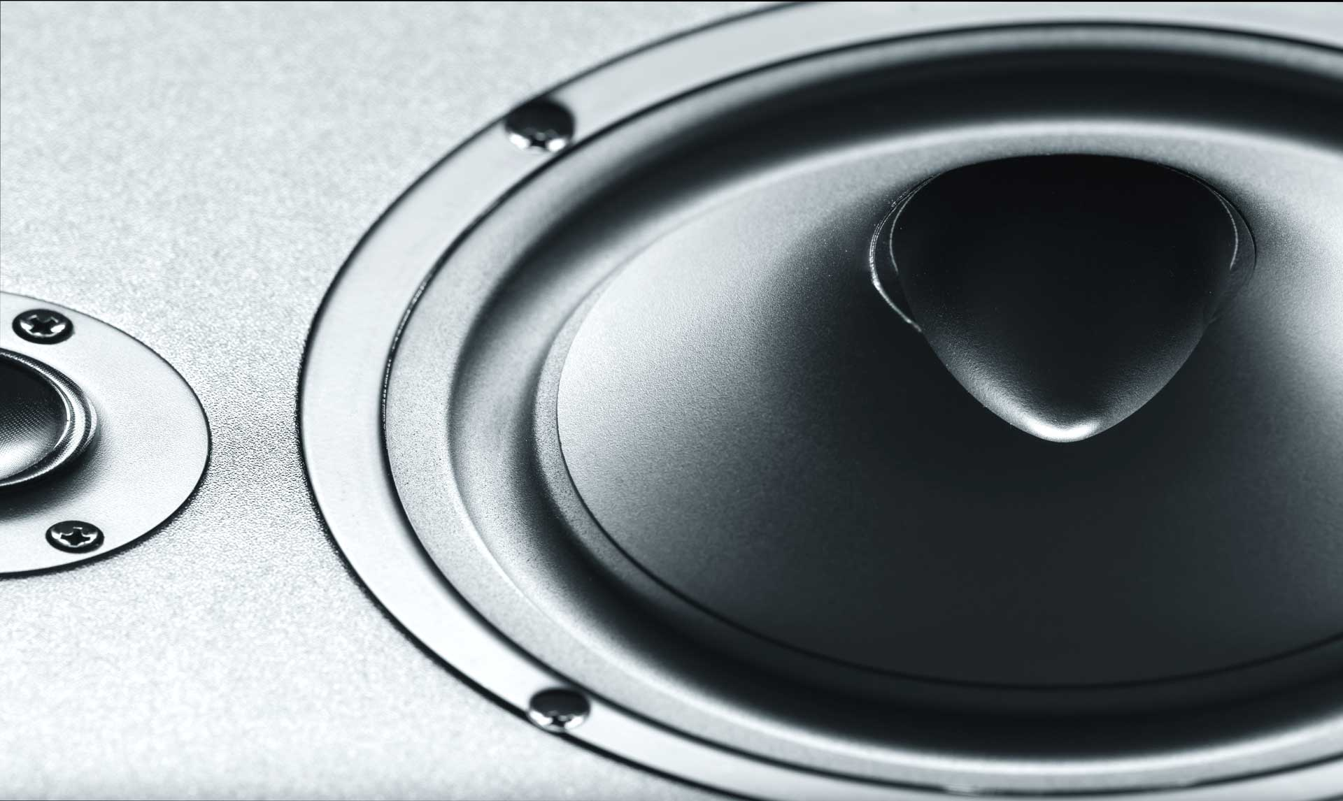 speaker and subwoofer mounted to a horizontal surface